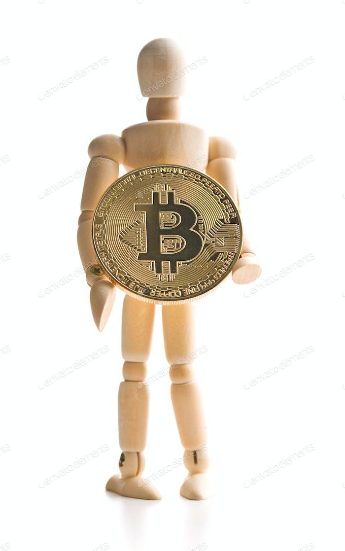 Moneda Bitcoin y títere de De madera.