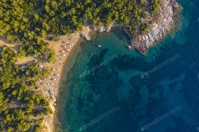 Aerial drone view of beach umbrellas and sunbeds on Thassos island, Greece