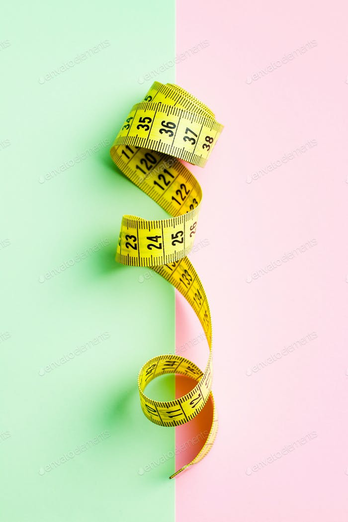 Yellow measuring tape of the tailor