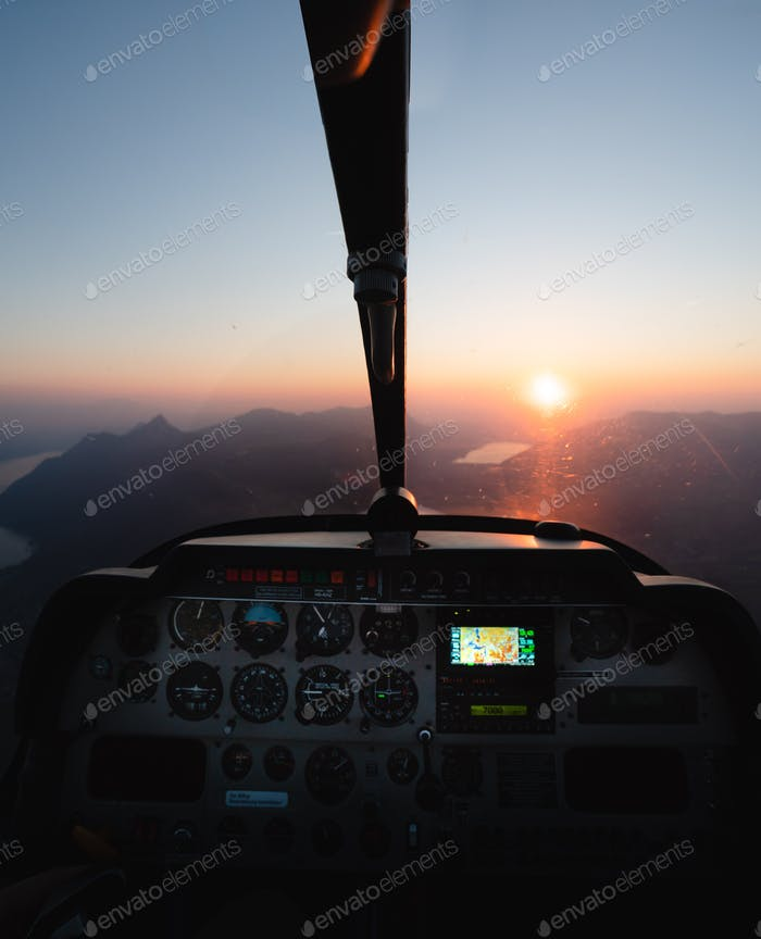 View out of small Airplane during Sunset