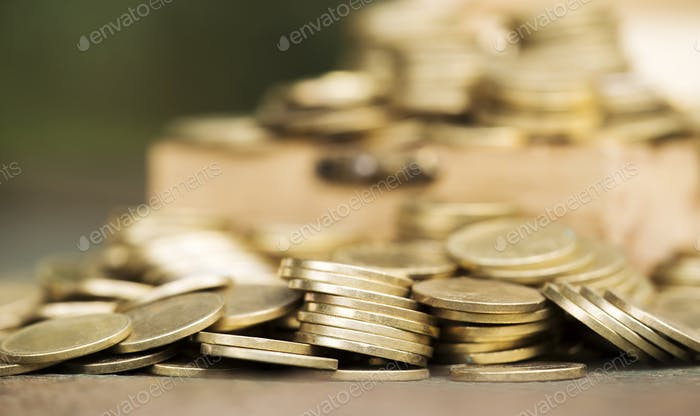 Financial planning concept - gold money coins background