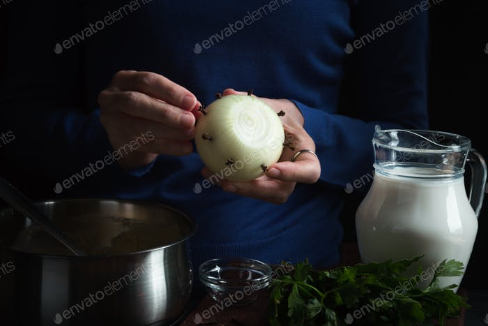 Bulb in hand, ingredients for bechamel sauce