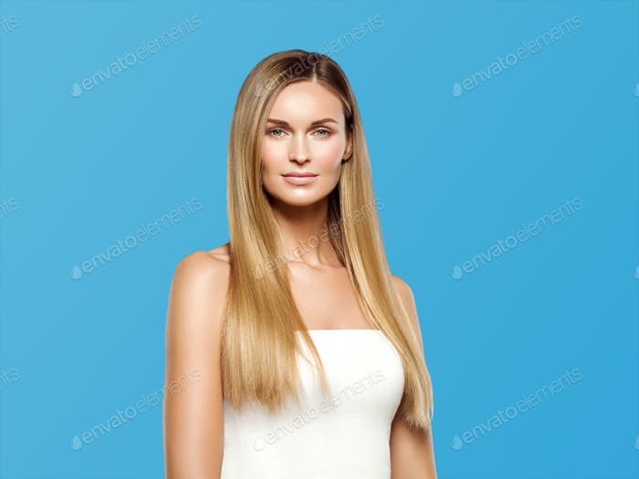 Beautiful woman long hair blonde natural portrait with beauty makeup. On blue.