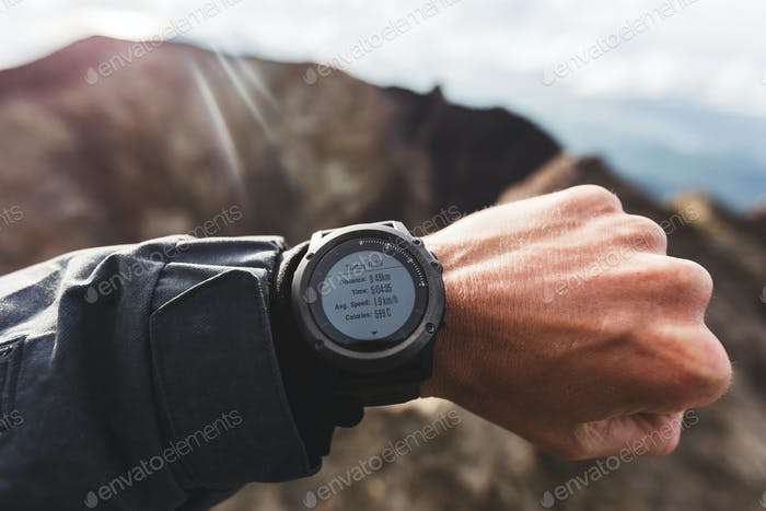 Agung trekking results on fitness watch. Finish after hiking at the top. Goal achievement,