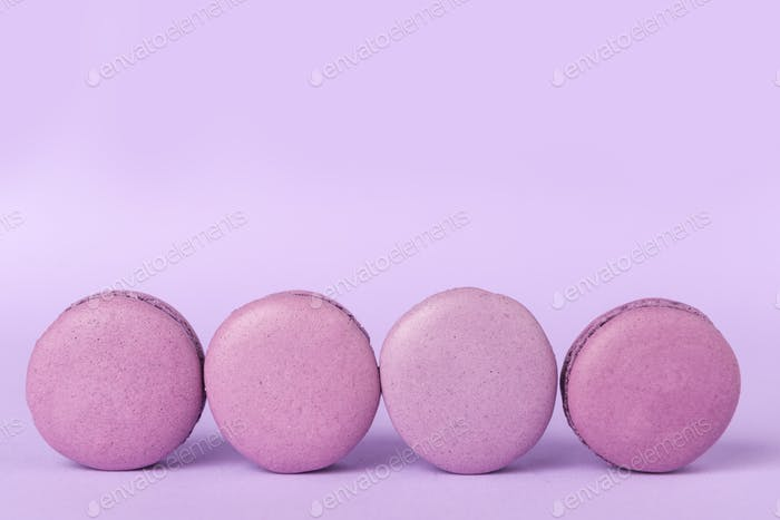 Four sweet purple macaroons