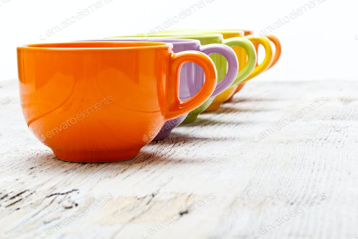 Row of color tea cups