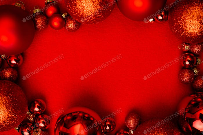 Christmas red background frame with red christmas balls.