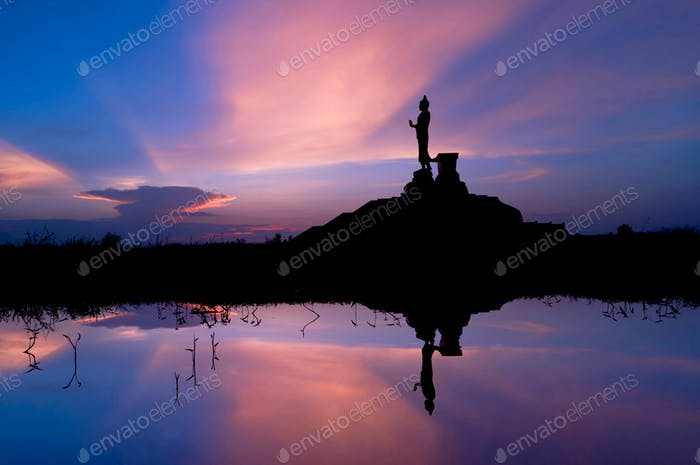 Big buddha statue with vivid sky