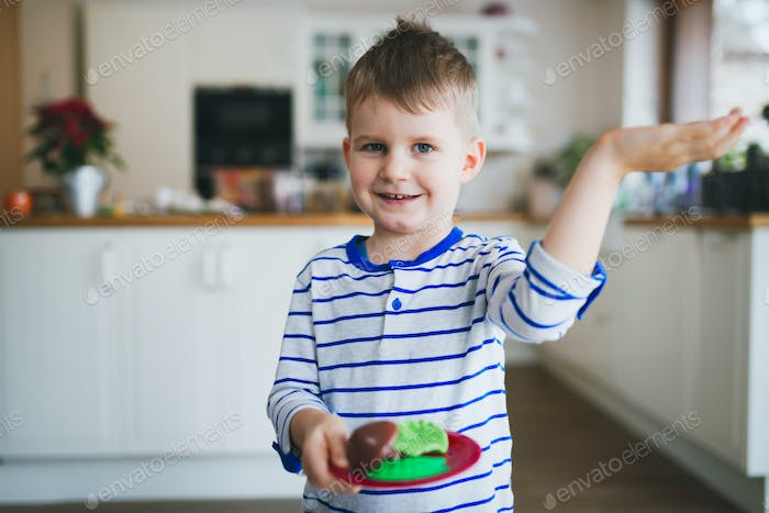 Happy young boy in kitchen