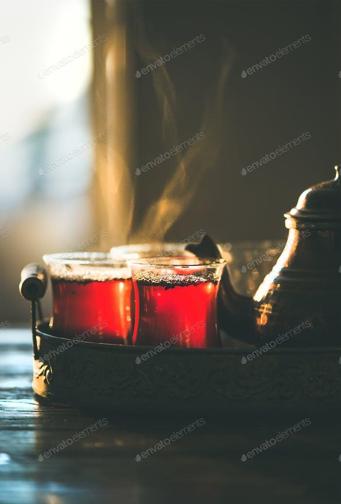 Freshly brewed traditional black tea in turkish tukip glasses