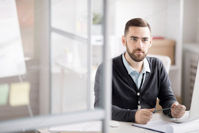 Thoughtful Businessman at Work
