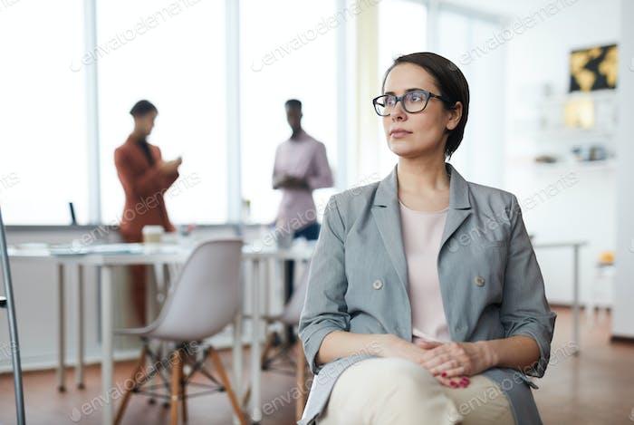 Modern businesswoman looking Away in Office