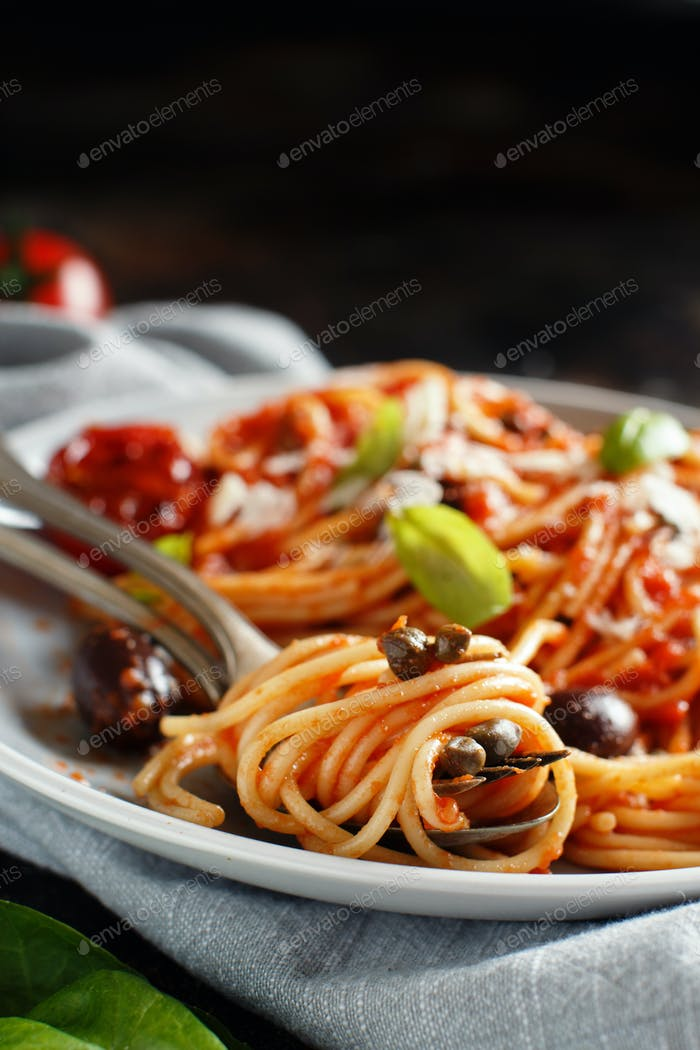 Spaghetti with tomato sauce olives and capers