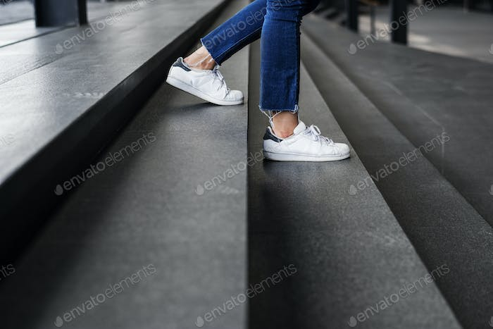 Closeup of person walking down the stairs