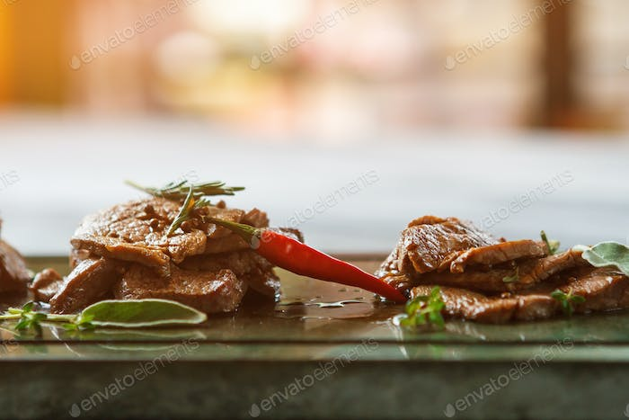 Slices of meat and pepper