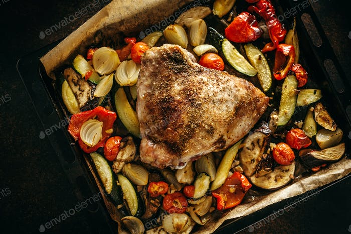 Tasty baked meat poultry with vegetables