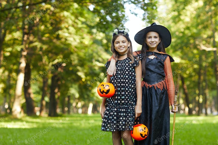Girls in witches costumes