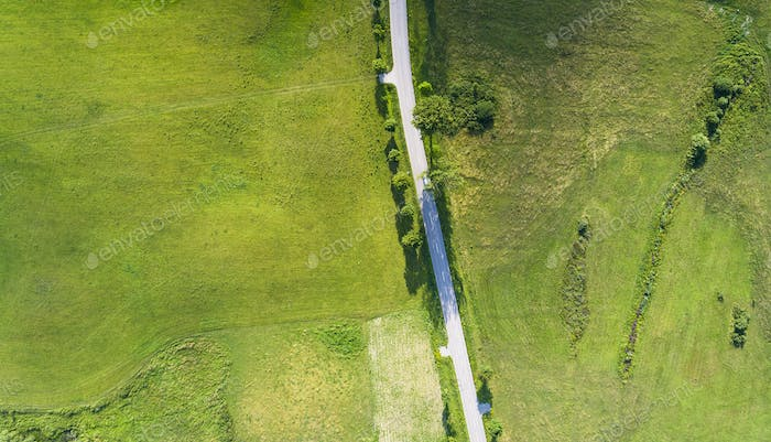 Aerial view of a country road between agricultural fields in Europe Germany
