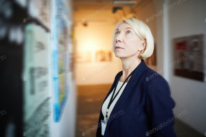 Mature Woman in Art Gallery