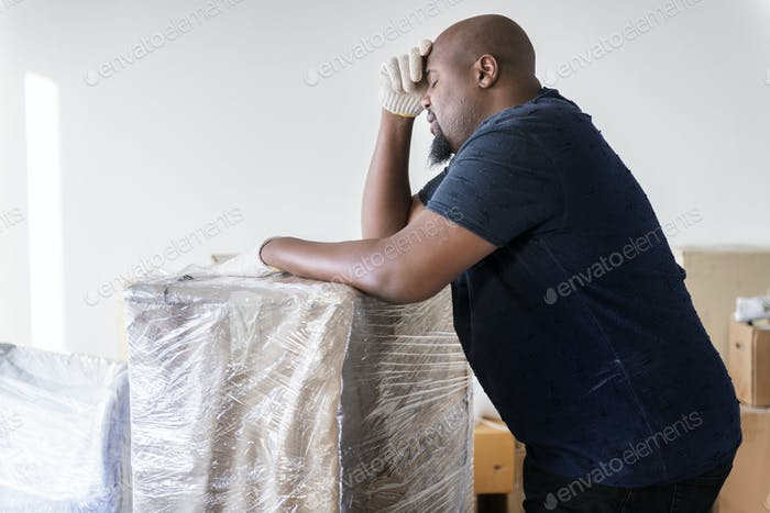 Black man moving furniture