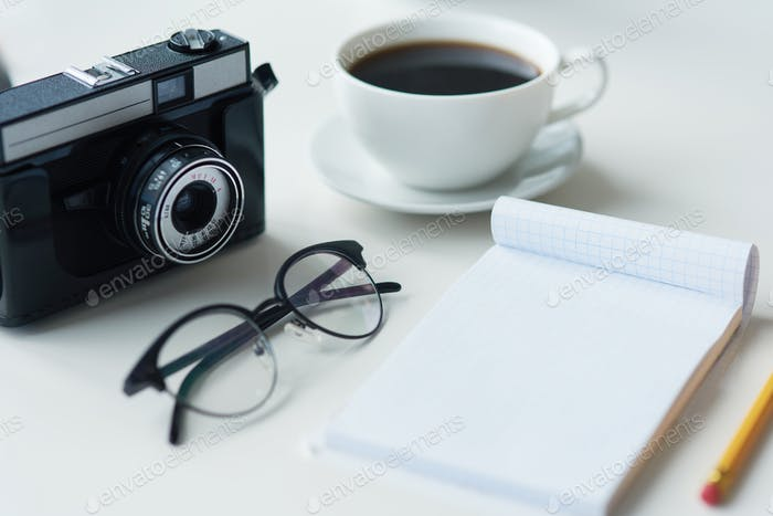 Camera with notebook and eyeglasses