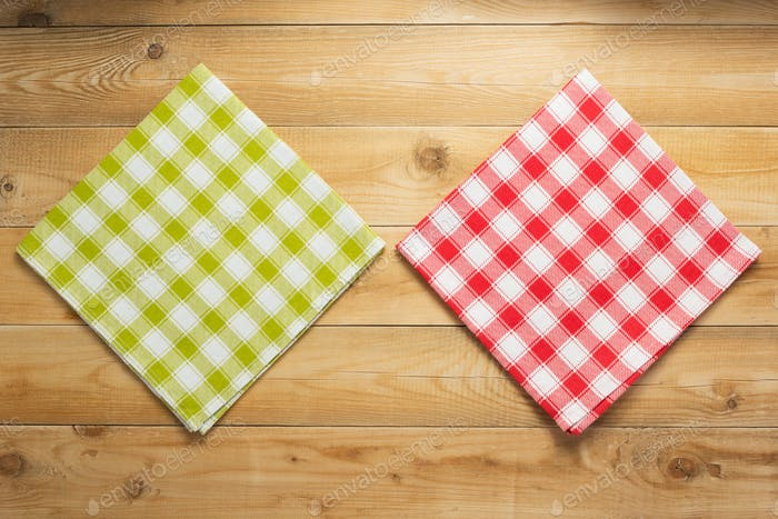 cloth napkin on at rustic wooden plank board table background