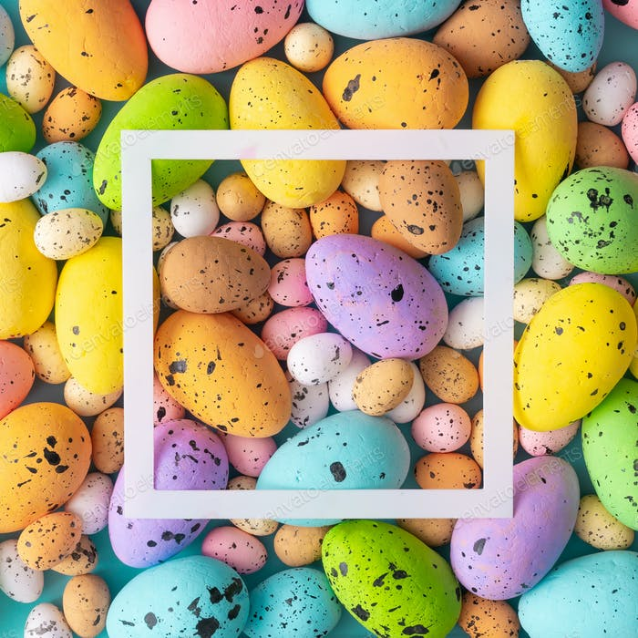 Easter composition made with colorful eggs. Creative holiday concept.