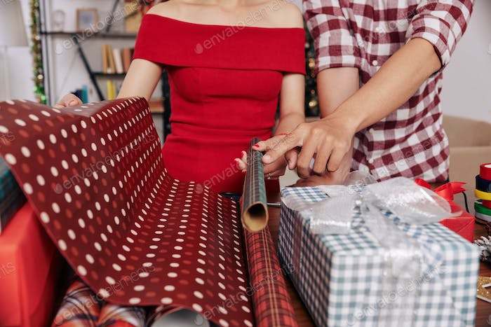 Couple choosing wrapping paper