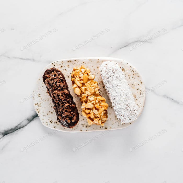 Healthy eclairs or profitroles on marble background