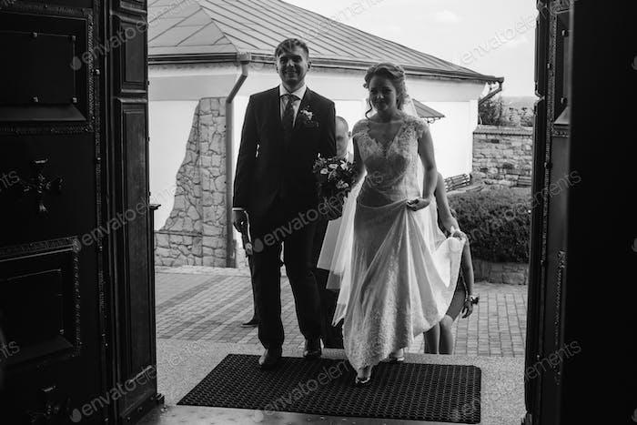 Happy couple entering church