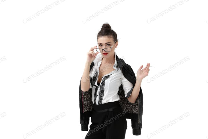 Woman in fur coat and eyeglasses smoking cigarette on white background