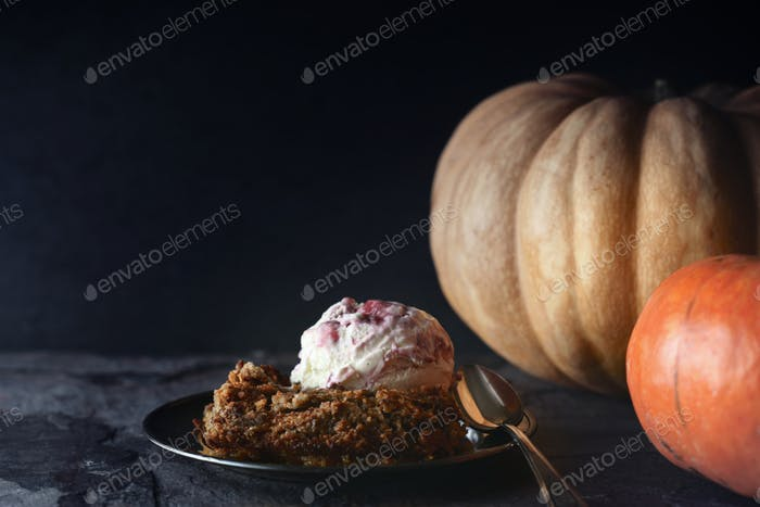 Pumpkin dump cake with ice cream on the stone table horizontal