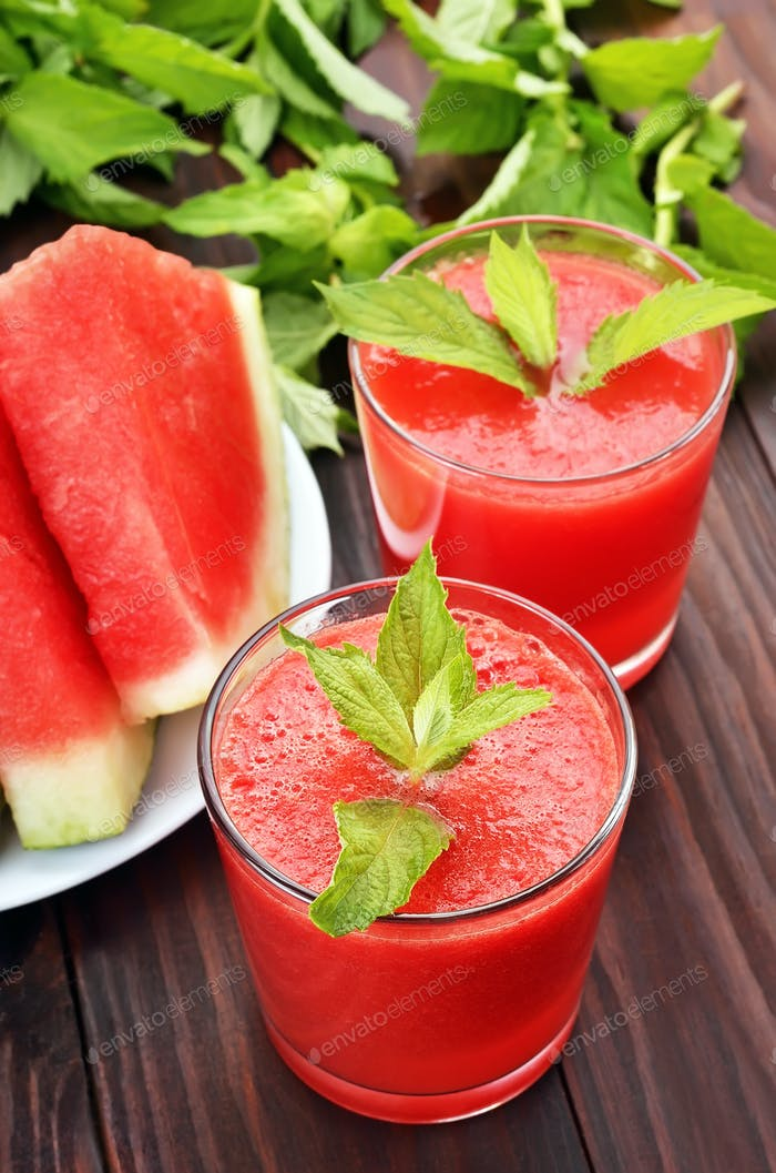 Watermelon cocktail with mint in glass and slices