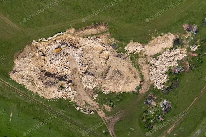 Aerial view of excavator working in a limestone quarry