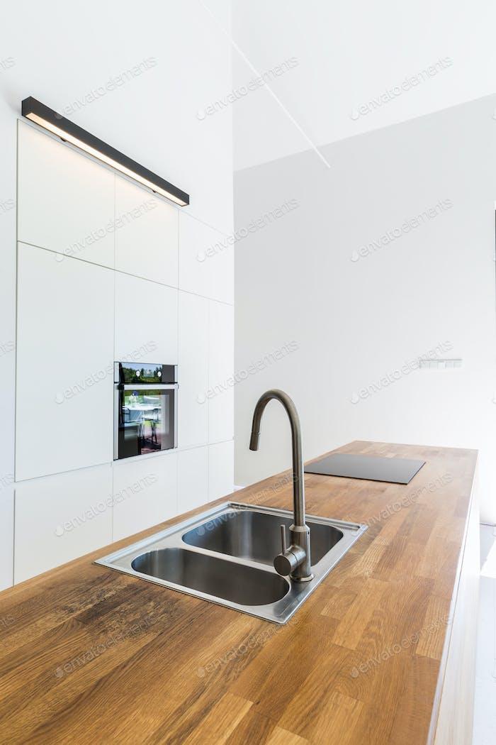 Modern minimalist kitchen with built-in cabinets