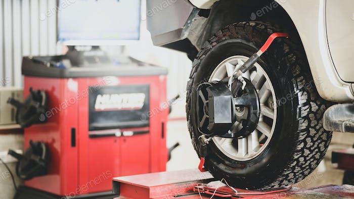 Car wheel alignment, car care, car suspension check.