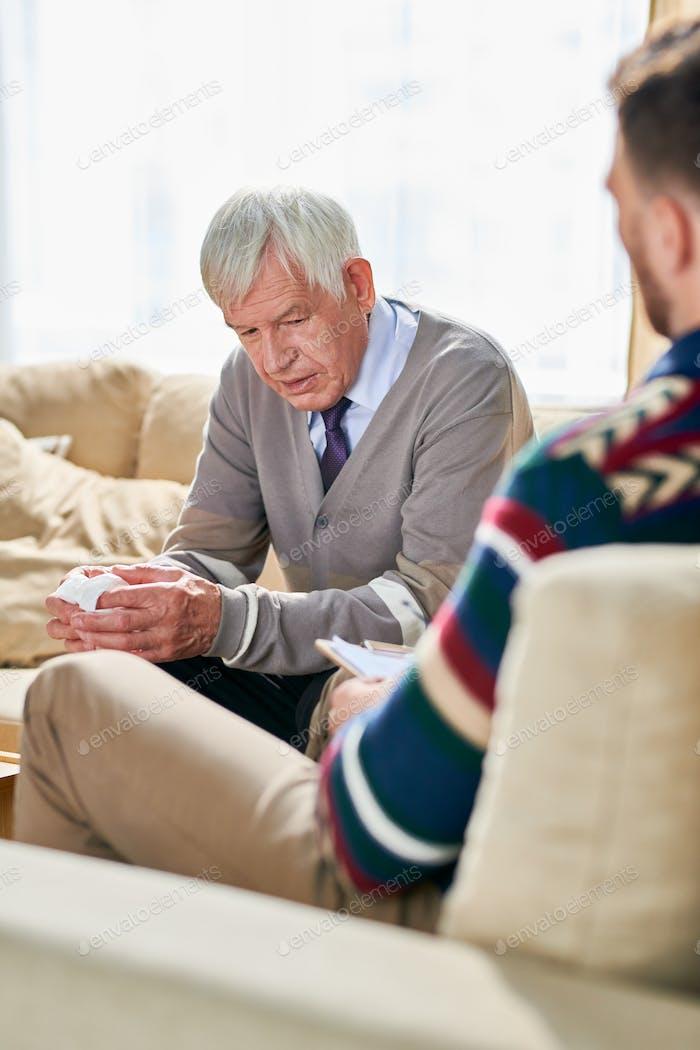Elderly man visiting shrink