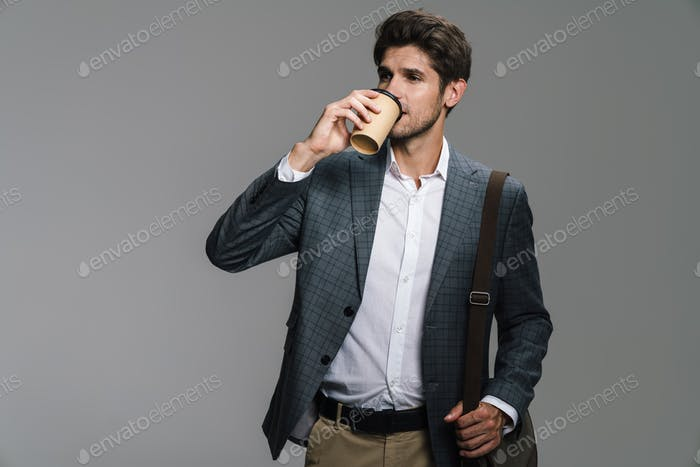 Photo of respectable confident businessman drinking coffee takeaway