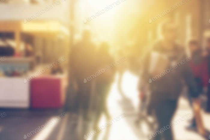 Crowd of people on the street, blur defocussed image