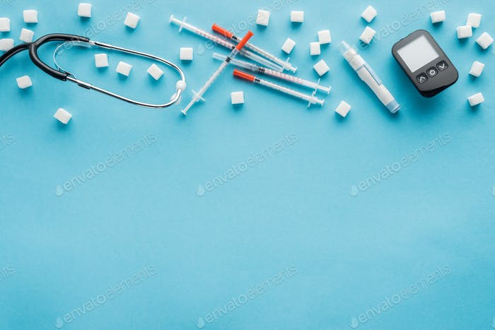 top view of diabetes medical equipment with copy space on blue background