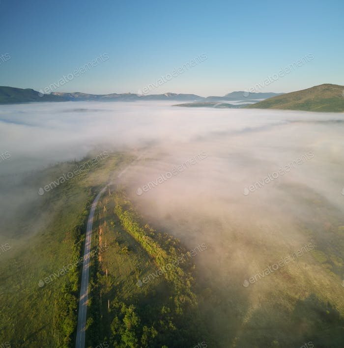 Fog in mountain and road at morning.