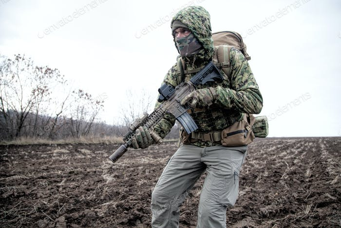 Portrait of modern army infantryman on march