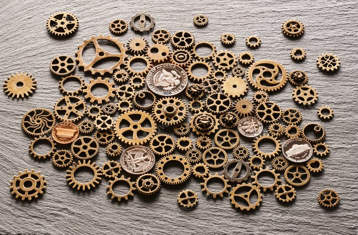 Various metal cogwheels with USA coins