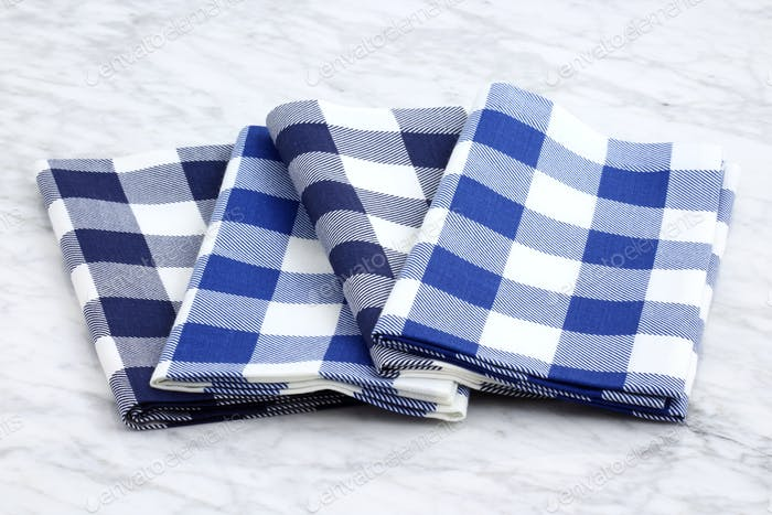set of fabric napkins on marble countertop