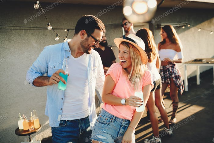 Happy couple having fun time at party