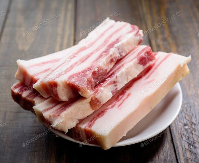 pieces of Iberian bacon on wooden board