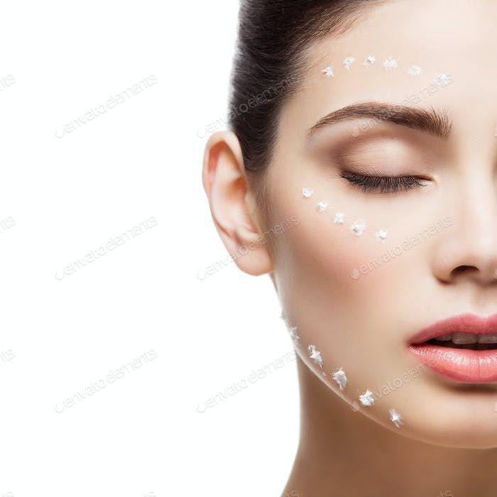 Girl with cream dots on face