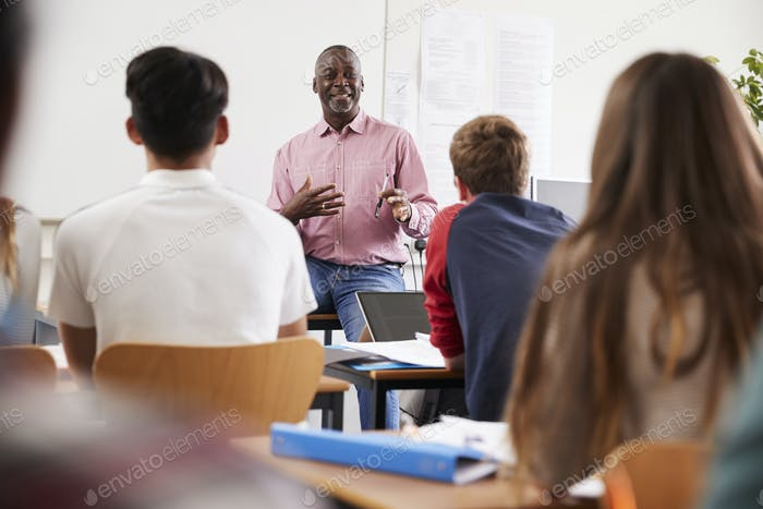Teacher Standing At Front Of College Students For Lesson