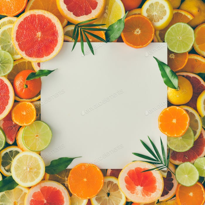Creative layout made of fruits with white paper card note. Flat lay. Tropical concept.