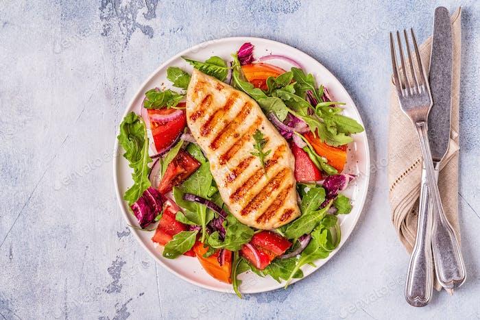 Chicken breast with fresh salad.